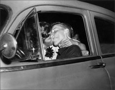 Teenagers Necking in car, 1954