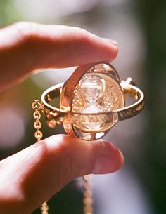 Harry Potter Time Turner Necklace..I want this sooo badly! (my friend got me one of these, not exactly like the one from the movie but idc it's awesome uwu)