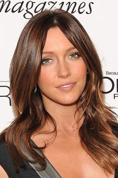 a warm chestnut for a spring do. Have your stylist apply honey highlights throughout your hair for this same look.