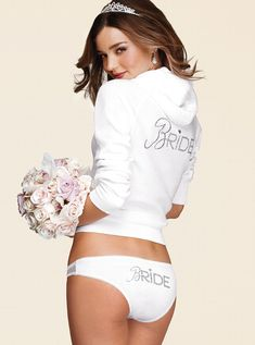 Miranda Kerr looking like heaven in bridal lingerie