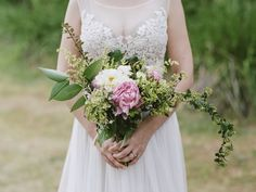 Overflowing bouquet with lush greenery and giant peonies. Colleen Riley Photography.