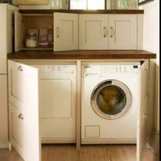 Love this idea.Hide washer & Dryer behind cupboards doors.