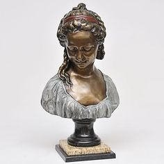 Busto em bronze patinado e policromado representando &#..