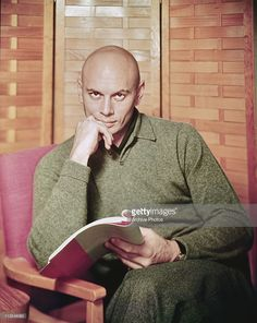 News Photo : Portrait of actor Yul Brynner with a script circa...