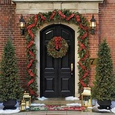 Front gate - Tartan Christmas garlands and wreath. The trees need some lights and color mixed in too.
