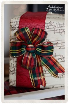 Christmas sheet music gift wrap with pretty plaid bow for that Old fashioned Christmas look!