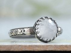 Handmade sterling silver ring with natural faceted rainbow moonstone. Ring band is antiqued. Made to order item.