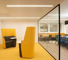 Yellow Meeting Room >> Meeting Furniture >> We love these bright yellow highed backed chairs that match the bright yellow carpet. This bright and stimulating #meetingroom has a partially open glass wall but the acoustic fabric and shape of the chairs means that sound can be contained within the space rather than travelling to the open meeting/dining space beyond. See more cool features of Superdrug's #newoffice and cool #officedesign ideas on our website... just click to see...