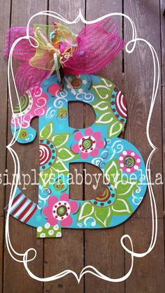 Personalized Initial Wood door hanger These letters are hand painted with acrylic paint & accented with glitter puffy paint . Letter Door Hangers, Initial Door Hanger, Wooden Door Hangers, Painting Wooden Letters, Painted Letters, Wood Letters, Wooden Door Signs, Wooden Doors, Painted Initials