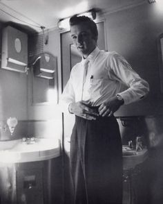 Getting dressed on the train, returning to Memphis.  He looks so sharp.  Love this outfit, the white woolen tie..@Wertheimer