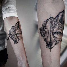 Half of the tattoo is a fox face. The other half is the fox skull ...