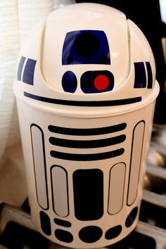 R2D2 wastebasket star wars. $16.00, via Etsy. So....this would be easy enough to do DIY, don't you think.  Buy a trashcan, mark it off, prime with plastic primer, paint and seal.