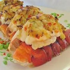 Grilled lobster tails stuffed with celery, green onion, and crabmeat seasoned with cayenne pepper and dry mustard. Delicious served with warm garlic lemon butter.