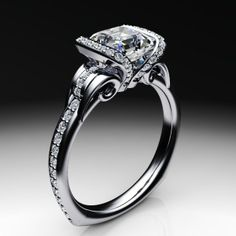 Diamond asscher cut engagement ring with side flanking diamond setting collars and scroll accents