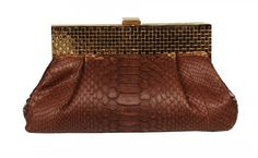 https://www.cityblis.com/7068/item/12773  Alva - Python Handbag - $600 by CASHHIMI  Clutch with decorative gold or silver plated frame closure. Main compartment 1 small slip pocket inside. Interior consist of leather lining. Entirely hand crafted. Size: W22 x H12 x D7 (cm)           W8,8' x H4,7' x D2,7' (inches)