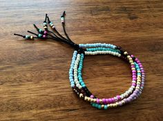Handmade Southwestern Style Seed Bead Bracelet **Please note that prices vary for different sizes - chose pattern A, B or C and approximate wrist size in inches at checkout** - Japanese glass seed bead on 100% cotton thread - Slide bead used to open/close bracelet - Can comfortably fit