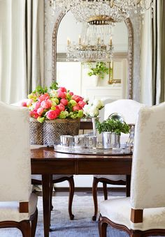 Niermann Weeks Quatrefoil Tole Planter holds a colorful array of flowers in this dining room by Iris & Co.