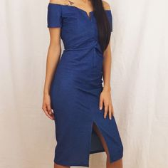 Off shoulder midi dress Beautiful blue denim style dress features an off shoulder sleeve and center slit. Fabric: 70% Cotton 24% Polyester 6% Spandex Dresses