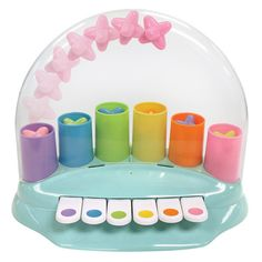 Pop! Pop! Piano, $24. How adorable is this toy piano? When you press a key, a star pops up. Develops cognitive learning, sensory development, emotional development. For ages 12 months +.