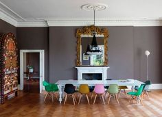 A huge white Farm Table and colorful Eames Chairs . That and more farm table and eames chair pairings, right this way. Chaise Eames Dsw, Eames Chairs, Dining Chairs, Dining Rooms, Eames Dining, Room Chairs, Dining Area, Upholstered Chairs, Side Chairs