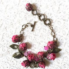 Antique Handmade Bronze Bracelet with Abundance of Closed Roses and Leaf Pendants - Pink ... by EnRose Jewelry on LaPrima Royale #LaPrimaRoyale