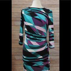 I just added this to my closet on Poshmark: CALVIN KLEIN XS Purple Teal Black Sheath Dress. Price: $35 Size: XS