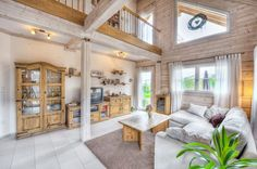 The living room has a high ceiling which gives it a spacious and airy feeling.  Honka log home in Frankfurt area, Germany.