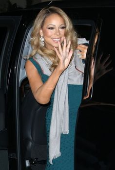 Mariah Carey waves at fans while out in NYC.