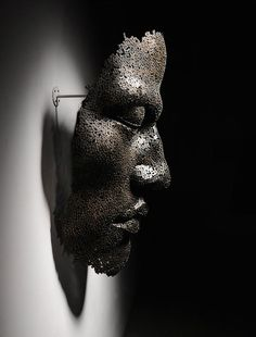 Large Bicycle Chain Sculptures of Meditative Faces - My Modern Metropolis