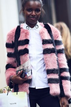 The Best Street Style At LFW SS17 #refinery29  http://www.refinery29.uk/2016/09/118817/street-style-lfw-ss17#slide-93  Yet another Shrimps fan. Model Leomie Anderson wears the Gustav checked faux fur jacket over the Wonky appliqué cotton shirt. ...