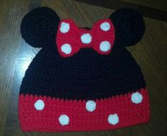 Black cap with your choice of color for the bottom dress portion. Comes with 3 dimensional ears and bow (same color as dress) with white polka dots on bow and dress portion. This item is machine washable ( I always put mine in a pillowcase) in cold water and can be dried on low. Sizing guide below:  Measurements are at rest with no stretching and approximate (different color yarns work up differently and can vary up to 1/2 ) I use red heart super saver yarn exclusively for hats.  0-6mont...