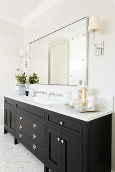 A Gorgeous Black Bathroom Vanity Sits On Maze Marble Floor Tiles And Is Ed W