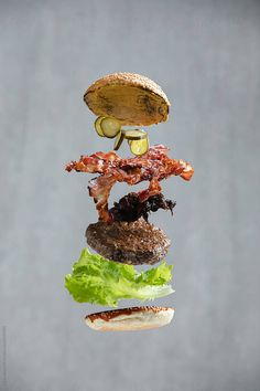 Burger with bacon, lettuce and cucumber.