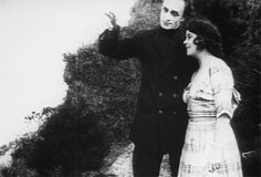 """[Animated gif of Conrad Veidt making a slow sweeping gesture, his other arm around a smiling woman]  """"And just outside the frame there, you can see all my fangirls. And boys. Conrad Veidt does not discriminate."""""""