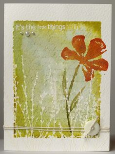 card with delicate background created with watercolour techniques using Distress Ink and water....