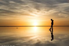 Solitude and serenity is conveyed by the image Mitzuka shot of a solo tourist strolling across the expanse at sunset