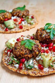 quinoa flatbread with falafel, feta & pomegranate