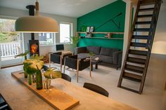 Emerald green interior, raw metal staircase, white painted floor. Interior by Hunting & Narud
