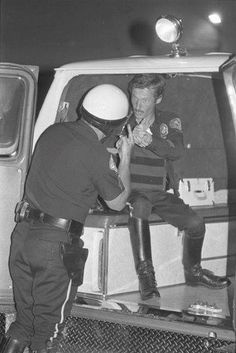 """Remember Eddie Haskell of """"Leave It to Beaver"""" fame? Ken Osmond, his real name, later became a LAPD Motor Cop. In September 1980, he was shot three times while chasing a stolen taxi. Two of the bullets struck his bullet-proof vest and the third ricocheted off his belt buckle. See photo, Ken in the ambulance."""