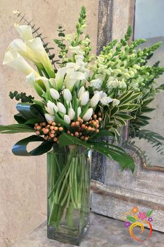 Wedding Flowers Fanfare - Local Delivery Only - This beautiful cluster arrangement combines callas, snapdragons, tulips and hypericum berries in a modern tall glass square vase. Finished with dark green leaf accents. Perfect for any occasion. Large Flower Arrangements, Vase Arrangements, Flower Vases, Flower Pots, Cactus Flower, Flower Bookey, Flower Film, Funeral Floral Arrangements, Church Flowers