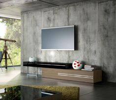 If you are looking to have your #TV in your living #room, a clean and uncluttered #wall unit can be excellent for creating that #minimalist look. Seen here: the Gramercy Wall Unit.