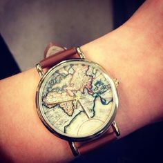 Vintage-looking wrist watch with a map background and a brown leather strap.