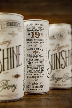 "Designed by Device Creative Collaborative | Country: United States  ""Inspired by the Appalachian legend of 19th century moonshiner Buck O'Hairen, Sunshine is a delightfully crisp, lightly carbonated pick-me-up with electrolytes, vitamin B12, natural ginger and flavors of blackberry.  The design harkens back to the hand lettering of the late 1800′s and the boom of medicine show culture throughout the US."""