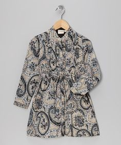 Classic, heirloom-quality fashion mingles with a charming print on this Indian-made dress. With front buttons, pretty pleats and a tied waistline, this cotton wonder blossoms as a wardrobe centerpiece.