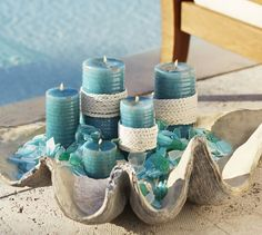 Seaside Pillar Candles | Pottery Barn. The big shell and sea glass with these candles....I'm in LOVE