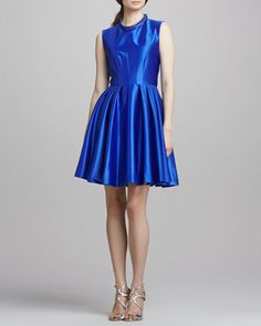 A brilliant blue party dress with a beaded jewel-neck from Mark James by Badgley Mischka #partydress #holidayparty #holidaydress #holidaystyle