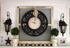 This eye-catching fireplace mantle holds a framed analog clock, suspended from a mesh-paned window by a piece of ribbon. See more at Down to Earth Style.