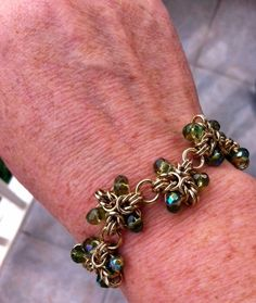 Front view of a 7-inch chain maille bracelet made with non-tarnish brass and glass stones (pattern courtesy of Scott Plumlee). The cost is $45, not including shipping and handling (back view shown above).