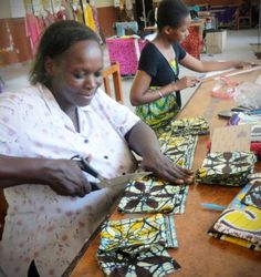 An artisan with Bombolulu Workshops, cutting fabric for our African Batik Coasters. serrv.org #fairtrade