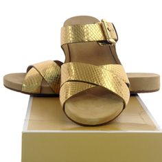 f8453ae330cf Shop Women s Michael Kors Gold size 8 Sandals at a discounted price at  Poshmark.
